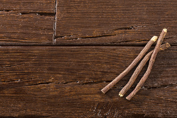 Licorice stems - Glycyrrhiza glabra. Wooden background