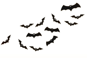 Halloween and decoration concept. Cute smiling black paper bats flying over white background. Halloween background.