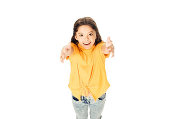 high angle view of adorable happy kid reaching hands and smiling at camera isolated on white