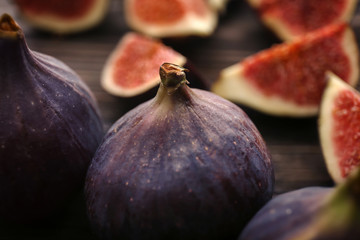 Fresh ripe figs on table, closeup