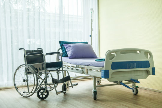 wheelchair and bed in the hospital waiting used for sick people. the bed near window have light from sun shine
