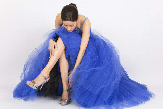 Beautiful young woman in blue prom dress