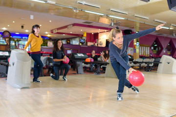 woman playing bowling