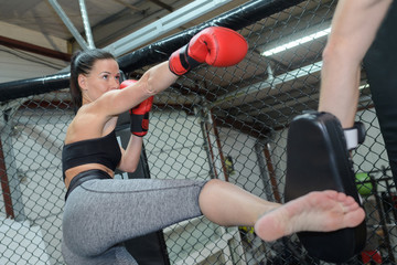 serious female boxer practicing punch