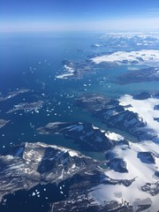 Aerial View of the Greenland Coast and Icebergs