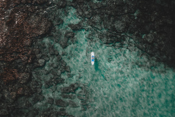 Small boat sailing in ocean