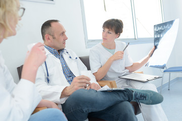 medical team meeting to discuss todays cases