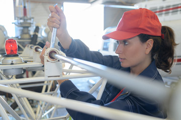 female engineer adjusting metal frame