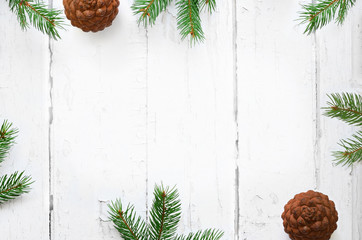 Fir branch on old wooden shabby background with copy space for text. Christmas.
