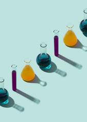 Row of test tubes with liquid, cyan background