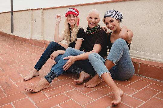 Women sitting on tile floor and smiling