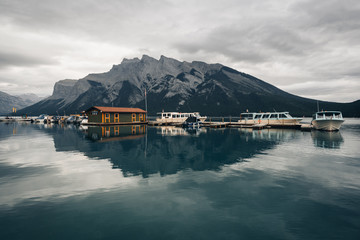 Boat houses on lake in Alberta, Canada