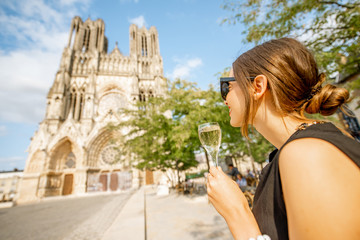 Woman with a glass of champagne in Reims, France