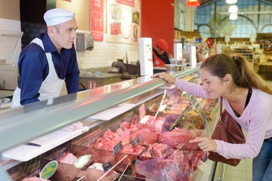 male butcher and female customer at butchery