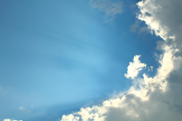 Large lush clouds and sunrays. Background. Landscape.