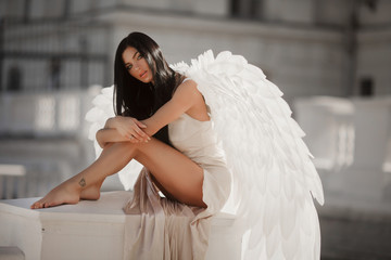 Fine art photo of a woman in white dress as an angel Wall mural