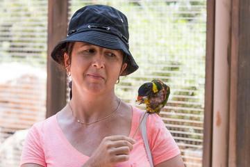 Young  woman feeds parrots at the Australian Zoo Gan Guru in Kibbutz Nir David, in Israel