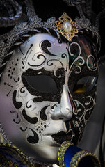 The traditional beautiful Venetian mask for participation in the carnival is shot close-up.