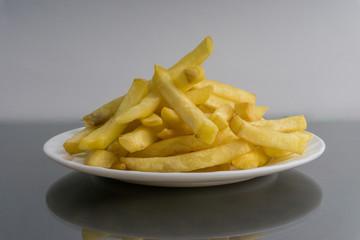 Potato fry or fries on dark background