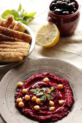 Beet hummus, olives and bread.