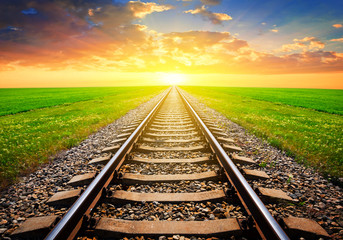railway leaving far away at the dramatic sunset
