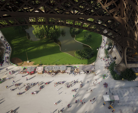 High angle view of people on footpath below Eiffel Tower in city
