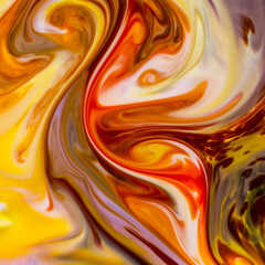 Macro shot of colorful abstract pattern of colors, milk and dishwashing liquid