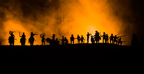 American Civil War Concept. Military silhouettes fighting scene on war fog sky background. Attack scene.