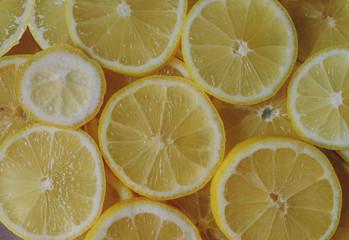 Fresh organic ripe lemons, lemon slices, top view