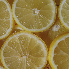 Fresh organic ripe lemons, lemon slices, top view