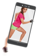 Beautiful young happy sporty woman running fast. concept of image quality. freezing moving objects in the camera smartphone