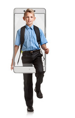 Portrait of smiling happy boy with knapsack going to school, concept virtual reality of the smartphone. going out of the device
