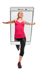 Young athletic woman in sportswear running on white background, concept virtual reality of the smartphone. going out of the device