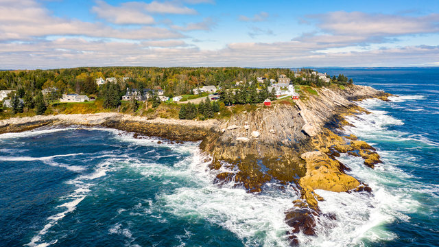 Aerial view of Pemaquid Point Light. The Pemaquid Point Light is a historic US lighthouse located in Bristol, Lincoln County, Maine, at the tip of the Pemaquid Neck.