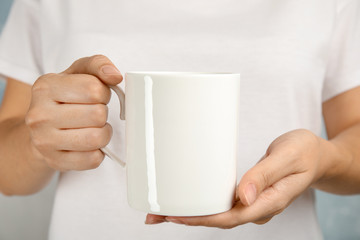 Woman holding ceramic cup, closeup. Mock up for design