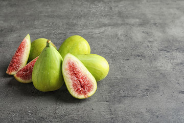 Fresh ripe figs on gray background. Space for text