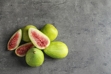 Fresh ripe figs on gray background, top view.  Space for text