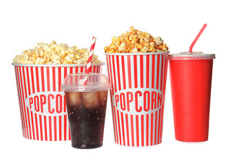 Delicious fresh popcorn and cups with beverages on white background