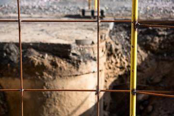 Yellow metal fence on asphalt repair