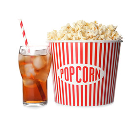 Bucket with delicious popcorn and glass of cola on white background