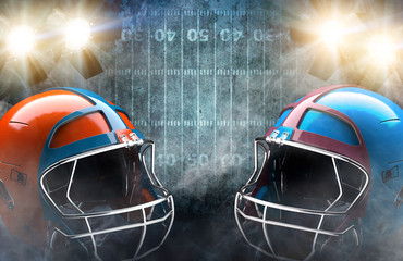 Two helmets and football on field with spotlight background. Concept for games in American football.