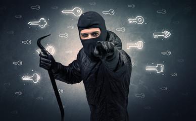 Burglar standing with tools in his hand.