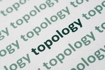 word topology printed on paper macro