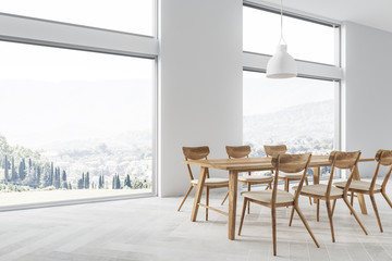 White dining room interior, mountain view, side