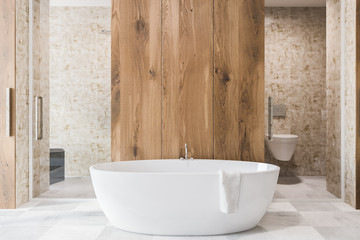 Wooden bathroom interior, white tub
