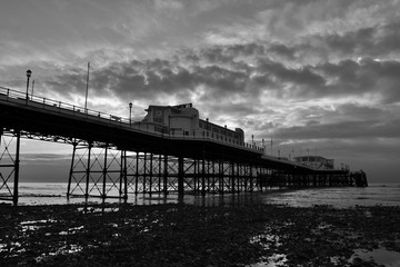 Black and white photo of Worthing pier at dawn