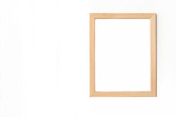 Blank light wooden frame for picture hanging on white wall. Realistic vector illustration