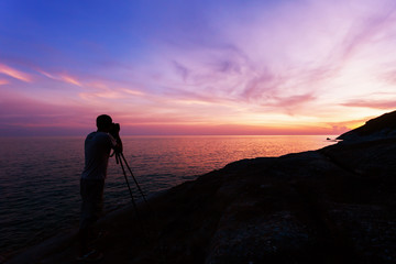 Professional photography on the stones in sunset or sunrise dramatic sky over the tropical sea in phuket thailand