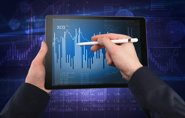 First person hand using tablet and checking financial report on cloud computing system