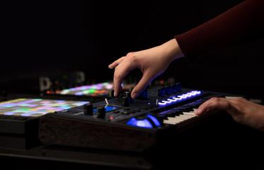 Dj hand remixing music on midi controller